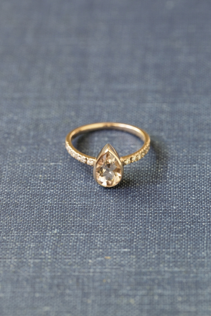 Local artisan Sea + Stone's 14K rose gold ring with pear-shaped morganite center and pavé diamonds (.18 total cts.), $1,525 from Kiawah Fine Jewelry