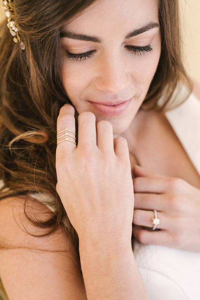 "Emma Katzka's ""Rachel"" comb with pearls and crystals from Lovely Bride. David Yurman's chevron ring with diamonds (.3 total cts.) from REEDS Jewelers. Jack Kelége's white and rose gold diamond (.68 total cts.) ring from Diamonds Direct. Charles Garnier ""Daniela"" gold and sterling mesh cuff with cubic zirconias from Croghan's Jewel Box. Matthew Christopher's ""Eden"" gown from Southern Protocol Bridal."