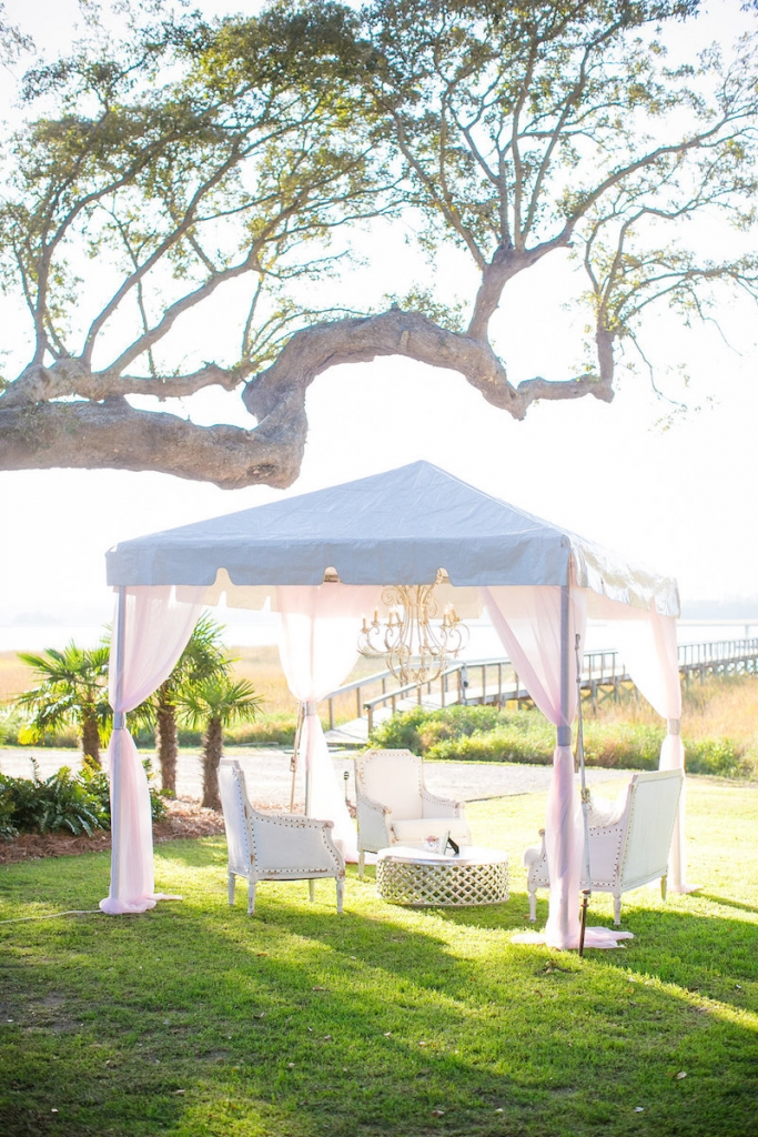 Wedding design by Pure Luxe Bride. Tent by Snyder Events. Lounge furniture by Nuage Designs. Photograph by Dana Cubbage Weddings at Lowndes Grove Plantation.