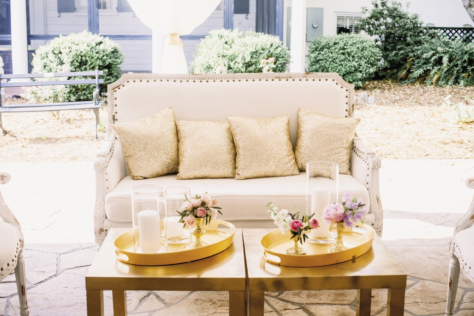 Gold sequin throw pillows gave linen-covered settees a glittering accent that answered the bride's dream of rustic-meets-glitz styling.