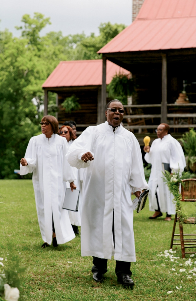 "To start the ceremony, Voices of Deliverance sang spirituals. Says Liz, ""It seemed important not to erase that part of the property's heritage."" <i>Photograph by Olivia Rae James</i>"
