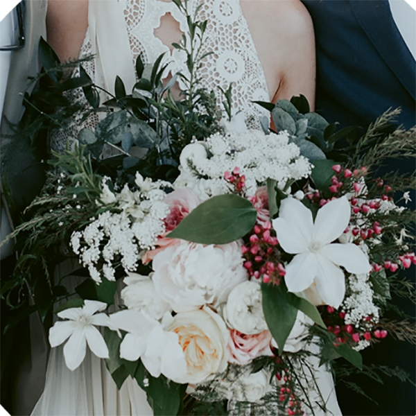 While a sometimes-florist acquaintance did tabletop flowers, Out of the Garden was called on to fashion the more complex, free-form bouquet Kaitlyn wanted.