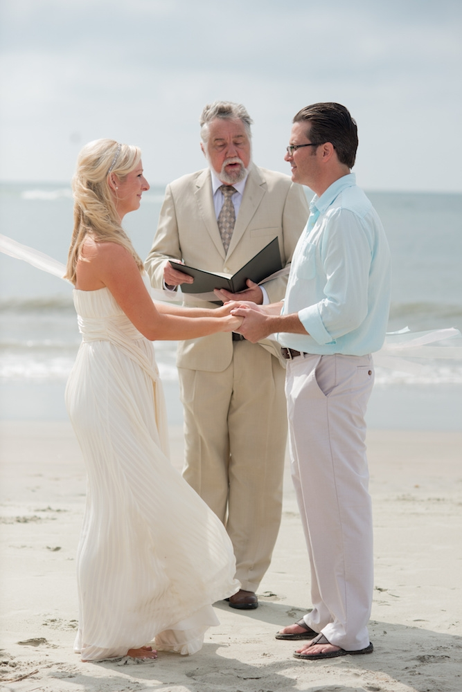 Bride's gown by BCBG. Menswear by Tommy Hilfiger and from Belk. Image by Leigh Webber Photography at Station 30 on Sullivan's Island.