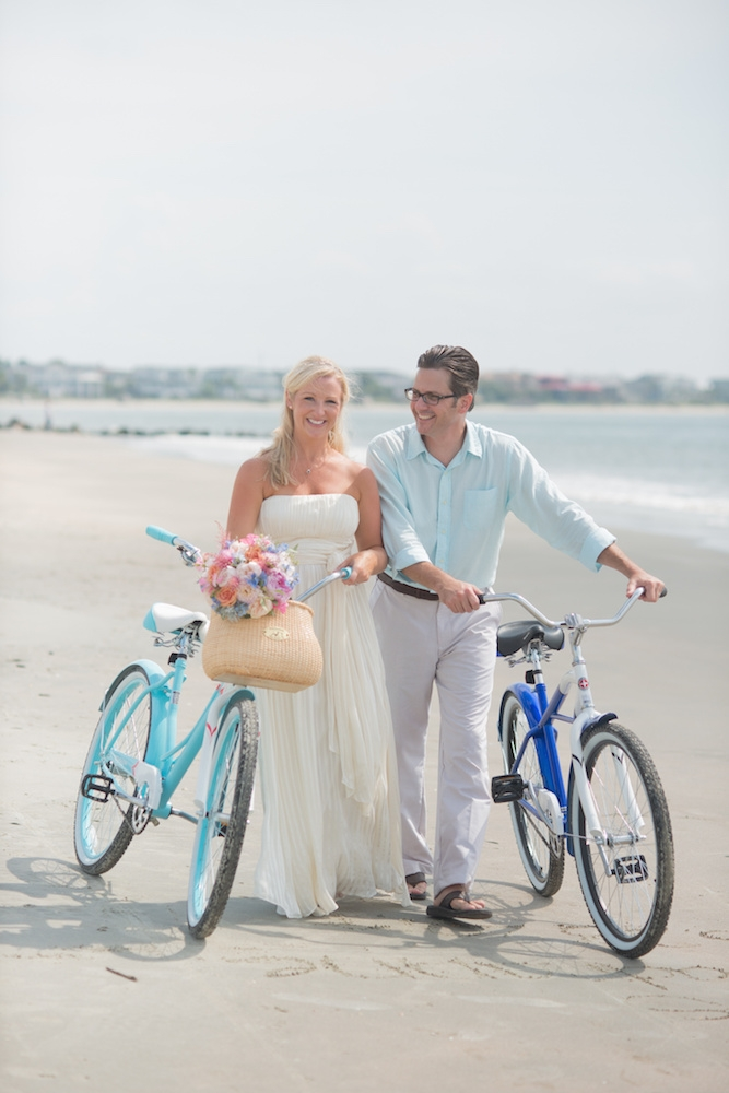 Bikes owned by couple. Bride's gown by BCBG. Menswear  Menswear by Tommy Hilfiger and from Belk. Image by Leigh Webber Photography at Station 30 on Sullivan's Island.