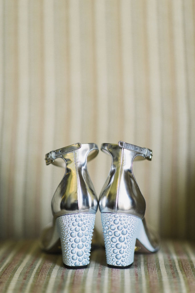 Bride's shoes by Prada and hand-painted by artist Wonderpuss Octopus. Photograph by Sean Money & Elizabeth Fay.