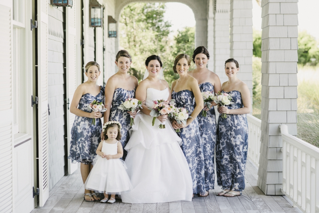 Bride's gown by Monique Lhuillier (available locally at Maddison Row). Bridesmaid dresses by Amsale (available locally through Bella Bridesmaids). Flower girl's dress by US Angels. Florals by A Charleston Bride. Photograph by Sean Money & Elizabeth Fay.