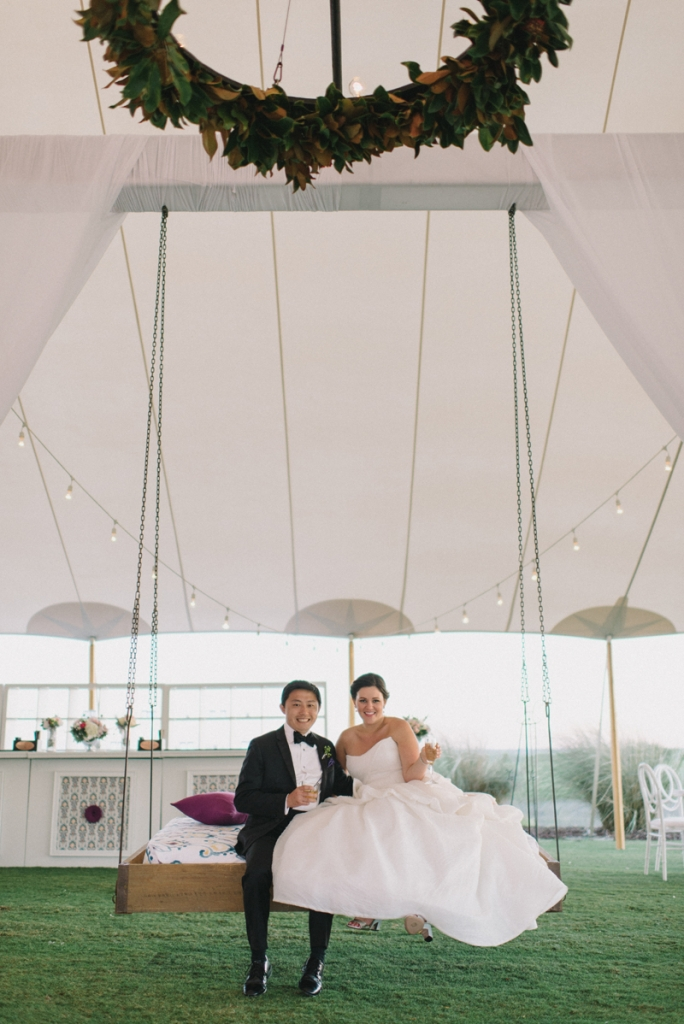 Wedding design by A Charleston Bride. Tent by Sperry Tents Southeast. Tent structure by Technical Event Company. Bride's gown by Monique Lhuillier (available locally at Maddison Row). Photograph by Sean Money & Elizabeth Fay at the Ocean Course at Kiawah Island.