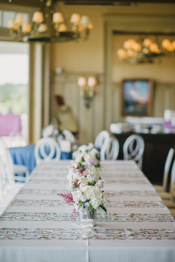 Wedding and floral design by A Charleston Bride. Linens by BBJ Linen. Custom fabric designed by Blue Glass Design. Photograph by Sean Money & Elizabeth Fay.
