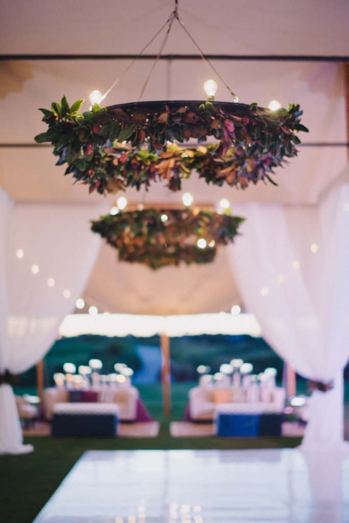 Wedding and floral design by A Charleston Bride. Lighting by Technical Event Company. Photograph by Sean Money & Elizabeth Fay at the Ocean Course at Kiawah Island.