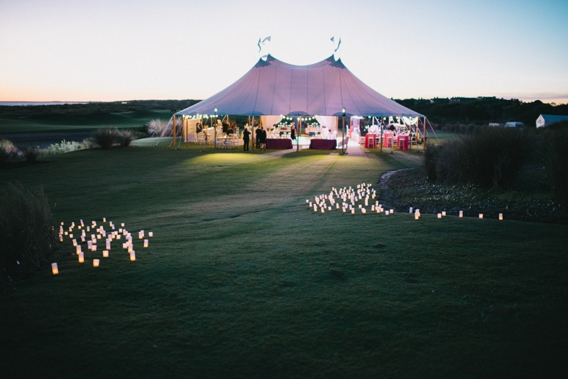 Tent by Sperry Tents Southeast. Wedding design by A Charleston Bride. Photograph by Sean Money & Elizabeth Fay at the Ocean Course at Kiawah Island.