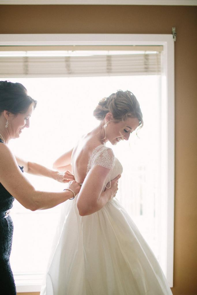 Bride's gown by Tara Keely. Hair by Krystal Yangco. Image by Julia Wade Photography.