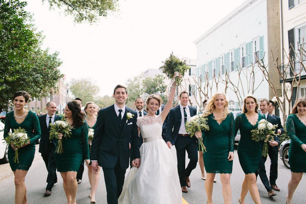 Bride's gown by Tara Keely. Bridesmaids' dresses by Adrianna Papell (available locally at Bella Bridesmaids). Florals by Lauren Luecke. Image by Julia Wade Photography.
