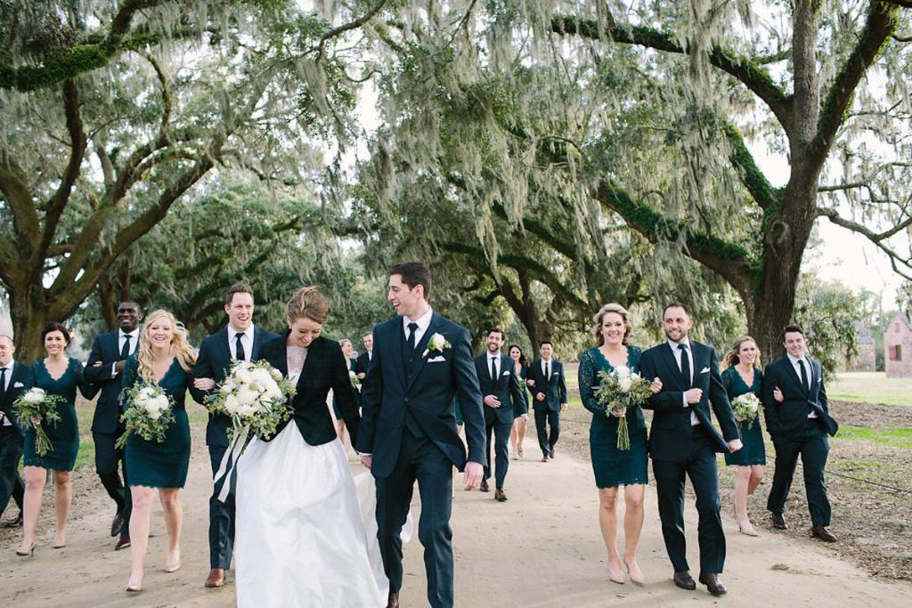 Bride's gown by Tara Keely. Bridesmaids' dresses by Adrianna Papell (available locally at Bella Bridesmaids). Florals by Lauren Luecke. Image by Julia Wade Photography at Boone Hall Plantation.