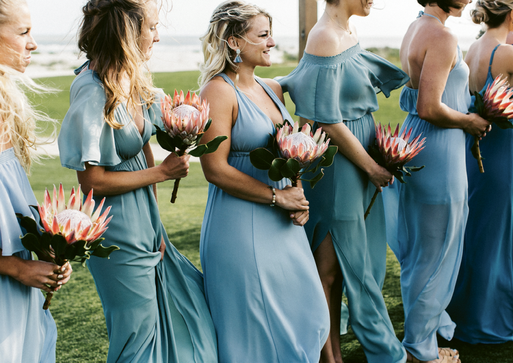 Bridesmaids carried single proteas down the aisle.