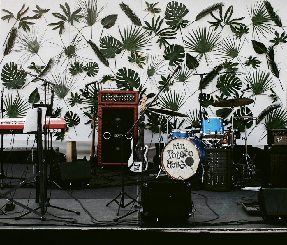 """A wall punctuated with tropical leaves made up the bandstand backdrop. The last song of the night was """"Don't Stop Believin'"""" by Journey, which had everyone on their feet."""