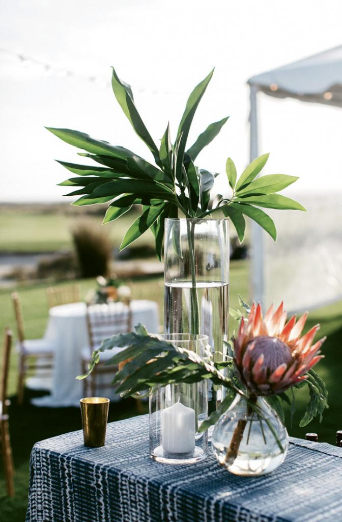 """Funky, unique, and naturally cool, the effortless look of this bar topped with exotic flora and shibori linens epitomized the wedding décor. """"It truly felt like a reflection of the two of us, one that we were able to share with those we love most,"""" Kaitlin recently wrote. """"Simply put ... BEST DAY EVER."""""""