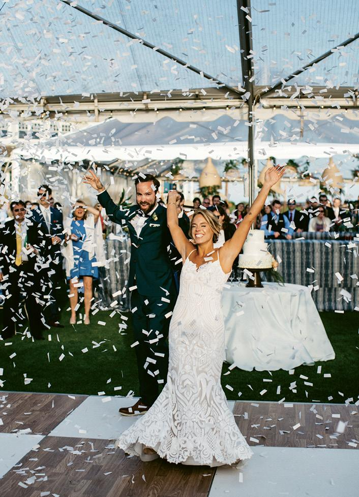 Windy conditions meant the couple couldn't shoot confetti cannons at their ceremony as planned. Their planner surprised them by setting them off when the newlyweds were introduced at their reception