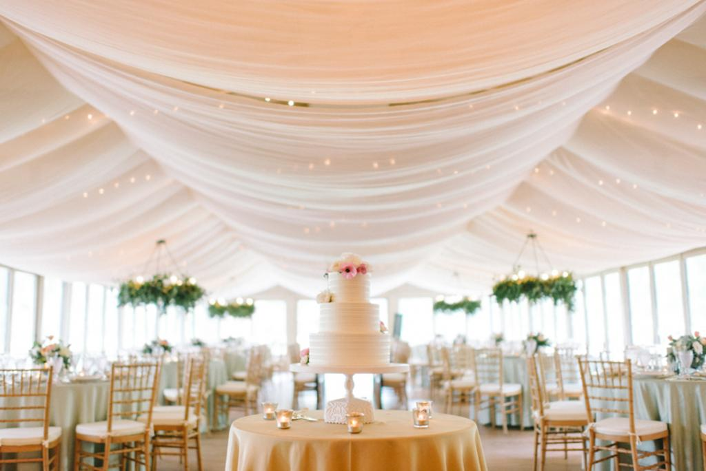Photograph by Sean Money + Elizabeth Fay. Design, draping, and florals by A Charleston Bride. Rentals by Snyder Event Rentals. Cake by Ashley Bakery.