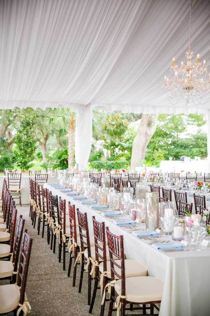 Wedding design by Pure Luxe Bride. Tabletop rentals and linens from EventWords. Tent from Snyder Event Rentals. Lighting by Innovative Event Services. Image by Dana Cubbage Weddings at Lowndes Grove Plantation.