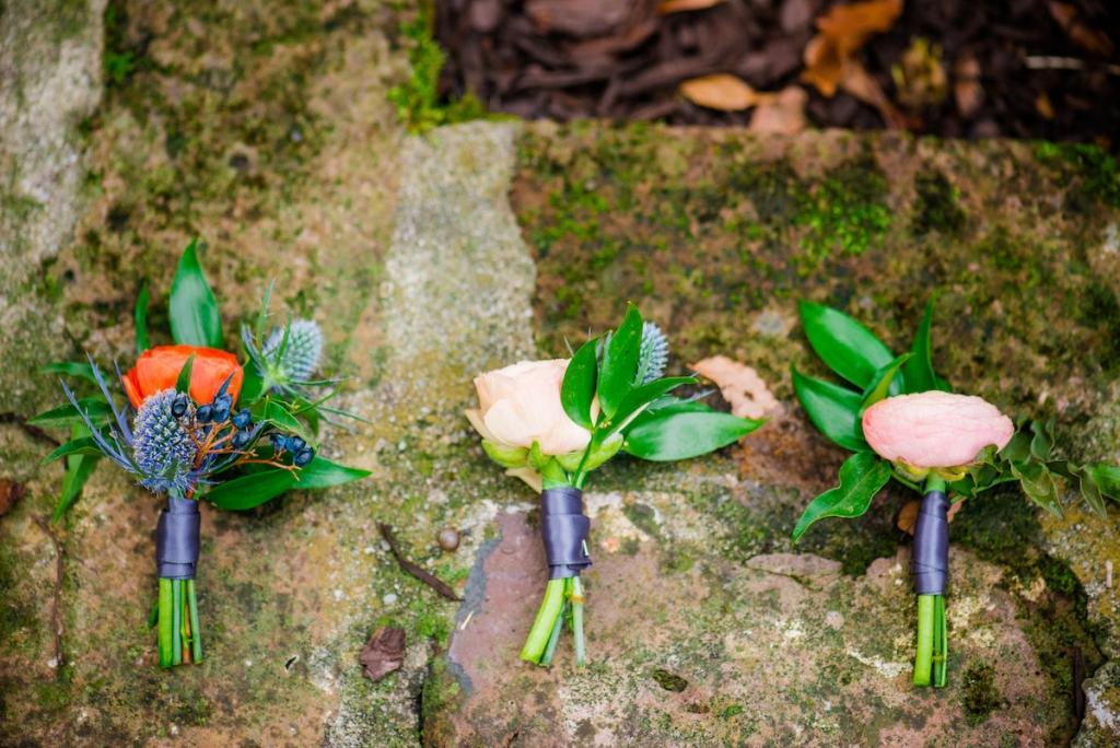 Boutonnières by Branch Design Studio. Image by Dana Cubbage Weddings.