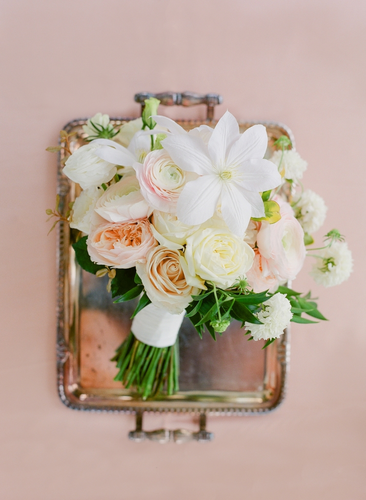 Meggie wanted the day's florals to evoke romance. Blossoms Events delivered in spades, using a springy mix of lisianthus, garden roses, clematis, ranunculus, and scabiosa for the bridal bouquet. <i>Image by Lucy Cuneo Photography</i>
