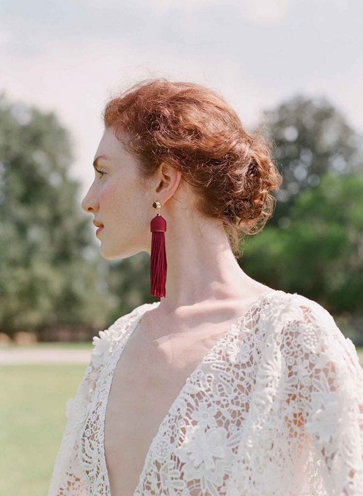 "Sarah Seven's ""Milo"" embroidered gown with draped sleeves and illusion V-neck from Lovely. Maroon tassel earrings from Out of Hand.   <i>Photograph by Corbin Gurkin</i>"