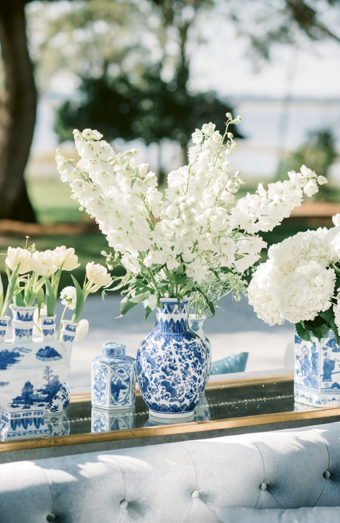 Pattered ginger jars from florist SYG Designs held double tulips, delphinium, hydrangeas, and more.