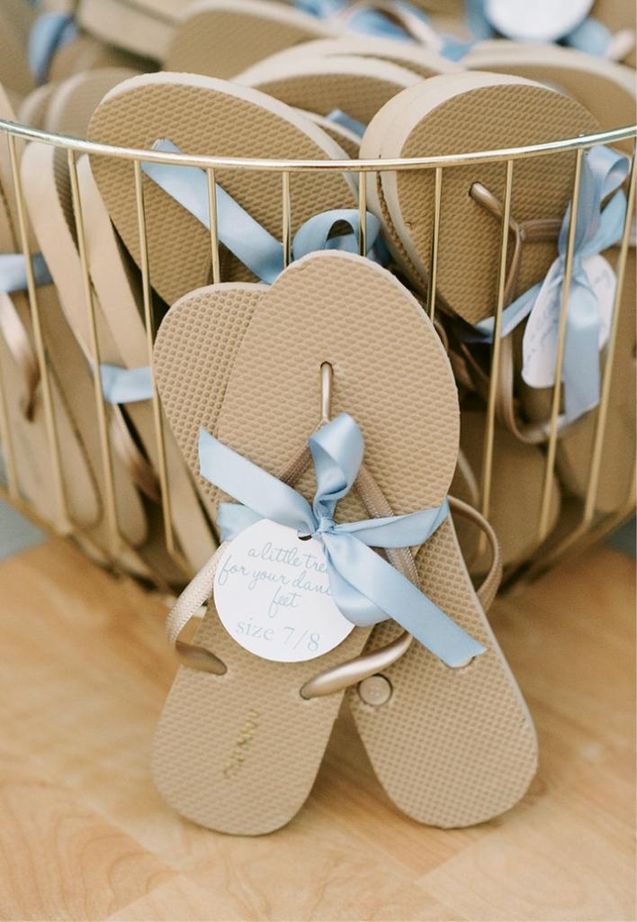 One of #ThePerksofGettingMarried? Golden flip-flops to ensure all danced the night away in comfort.