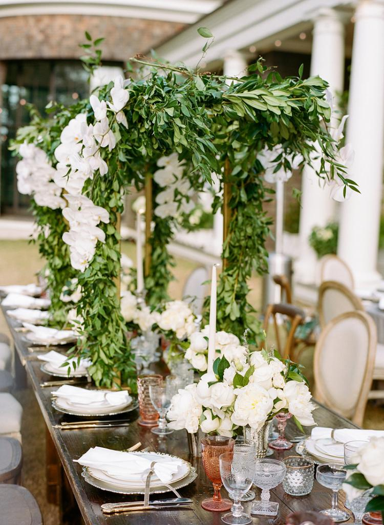 Table Talk - Cover trellis-style  frames in greenery and blooms to wrap dining tables in flora without cluttering place settings or obstructing eye contact.