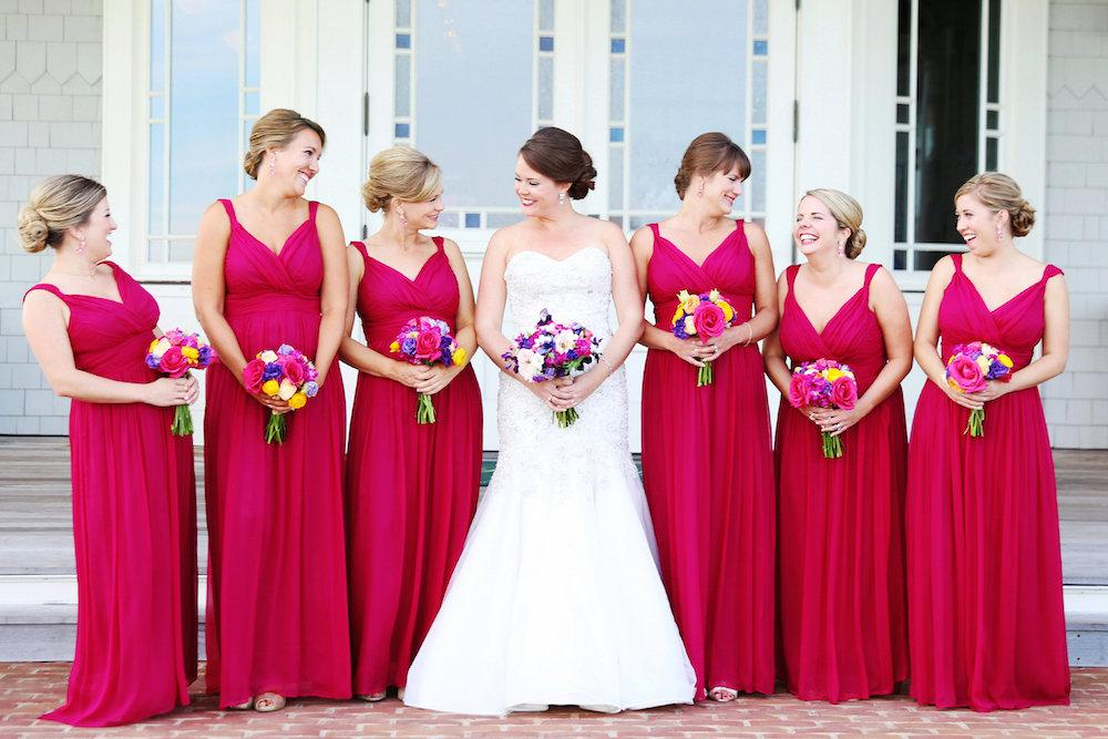 Bride's gown from Martina Liana (available locally at Gown Boutique of Charleston). Bridesmaid dresses by Donna Morgan (available locally at Gown Boutique of Charleston and Bella Bridesmaids). Image by Lindsay Collette Photography.