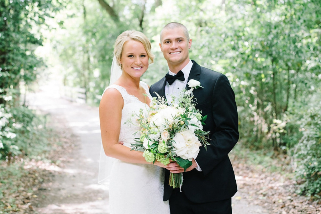 Image by Aaron & Jillian Photography at Magnolia Plantation & Gardens. Bride's attire by Mikaella. Hair by Paper Dolls. Groom's attire by Men's Wearhouse. Bouquet by Wildflowers Inc.