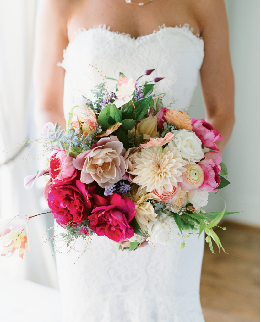 One of the bride's paintings (Folly Front) provided the palette inspiration for the wedding and for her bouquet by Stems. (Image by Natalie Franke Photography)