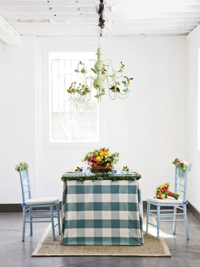 CHECK IT OUT: Large-scale checks blanket the table, and in  lieu of candles, calamondin oranges dressed the chandelier.