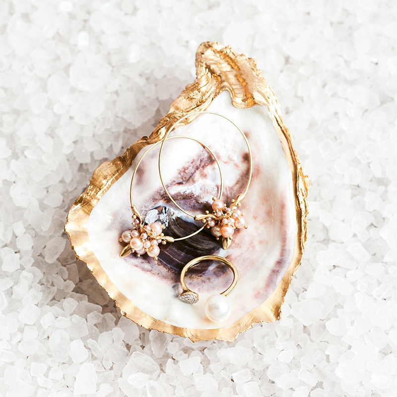 "Ted Muehling's pink pearl earrings from RTW (price upon request). Pavé diamond (.07 total cts.) and pearl gold ring from Diamonds Direct ($880). ""The Charleston Oyster Dish"" from Miller and Mare ($22).   <i>Photograph Gayle Brooker</i>"
