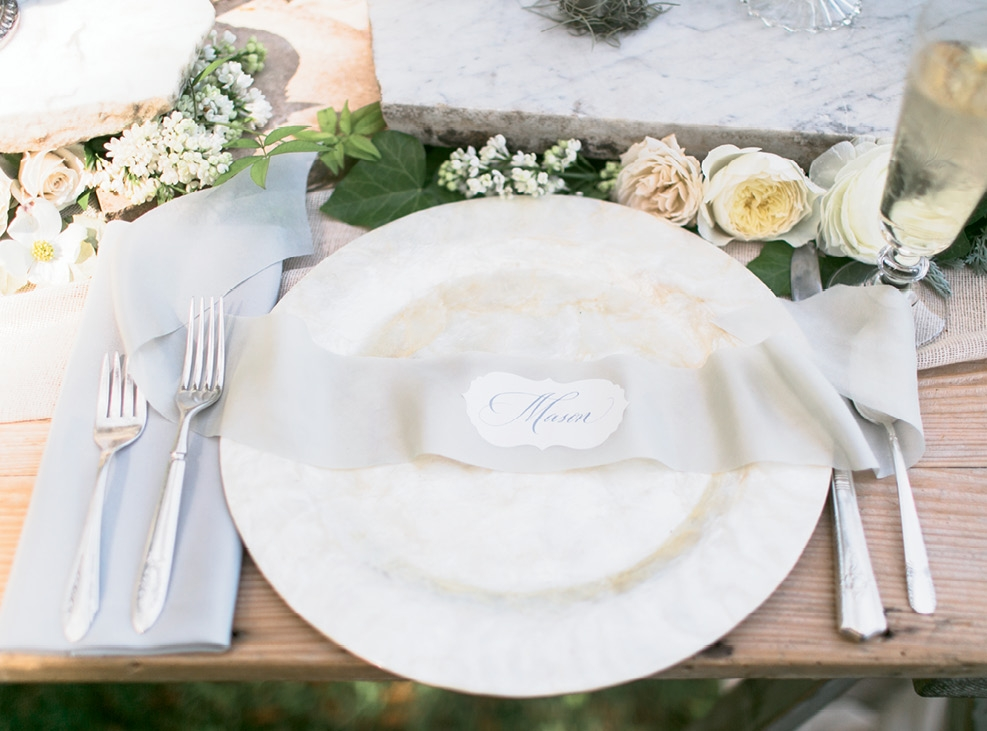 NAME THE PLACE: While these place cards were custom calligraphed, fashion your own when you print scripted names on stickers, then attach them to ribbons.