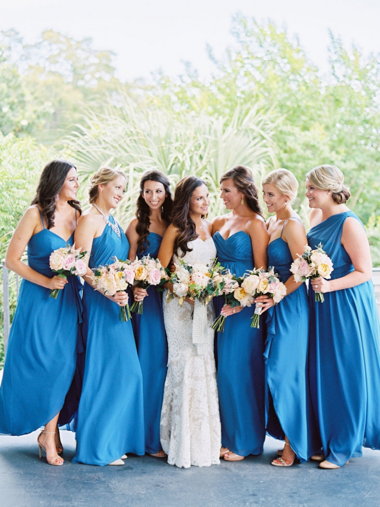 Bride's gown by Anne Barge, available in Charleston through White on Daniel Island. Hair and makeup by Ash and Co. Bridesmaid gowns by Alfred Angelo, available in Charleston through Bridals by Jodi. Florals by A Charleston Bride. Image by Ryan Ray Photography.