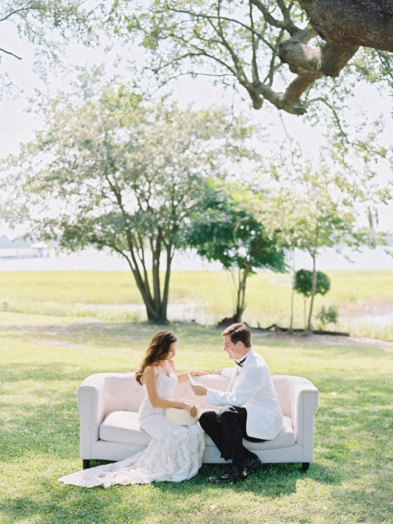 Bride's gown by Anne Barge, available in Charleston through White on Daniel Island. Groom's attire from Mens Wearhouse. Lounge furniture from Ooh! Events. Image by Ryan Ray Photography at Lowndes Grove Plantation.