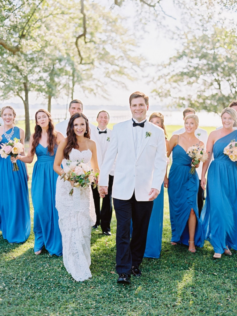 Bride's gown by Anne Barge, available in Charleston through White on Daniel Island. Bridesmaid gowns by Alfred Angelo, available in Charleston through Bridals by Jodi. Groom's attire from Mens Wearhouse. Image by Ryan Ray Photography at Lowndes Grove Plantation.