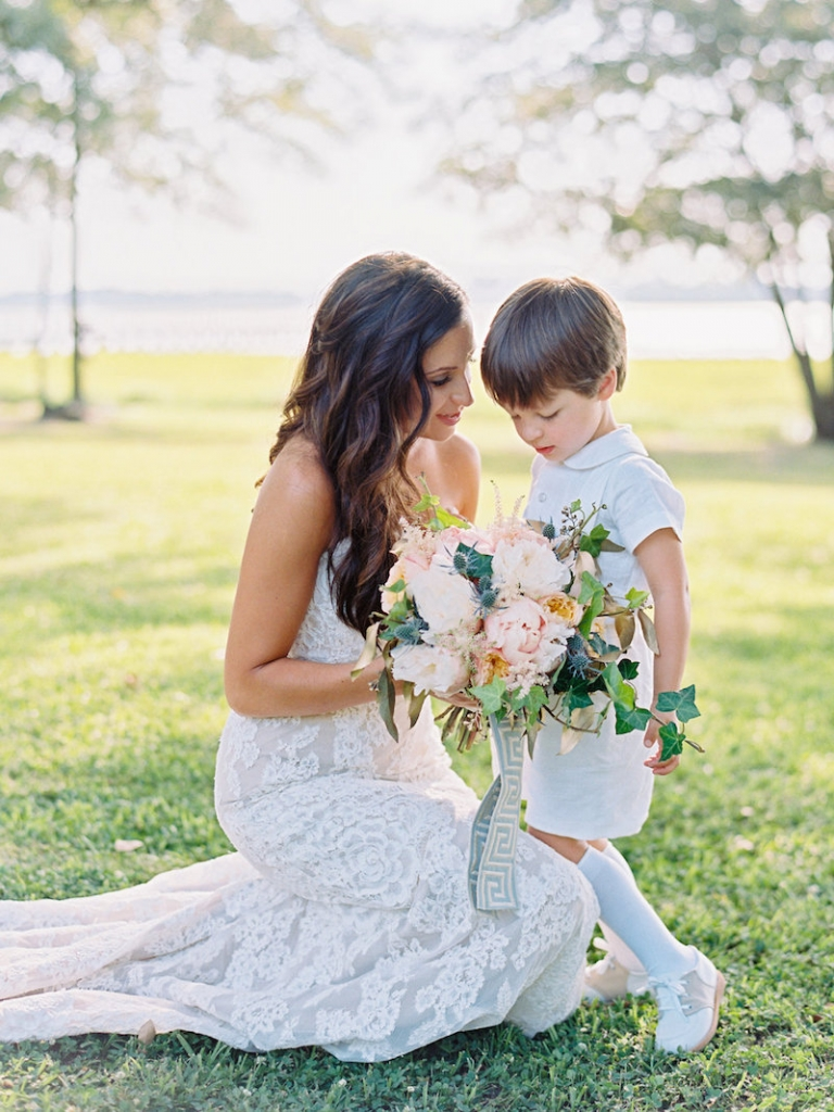 Bride's gown by Anne Barge, available in Charleston through White on Daniel Island. Ring bearer's attire by Florence Eiseman. Image by Ryan Ray Photography at Lowndes Grove Plantation.