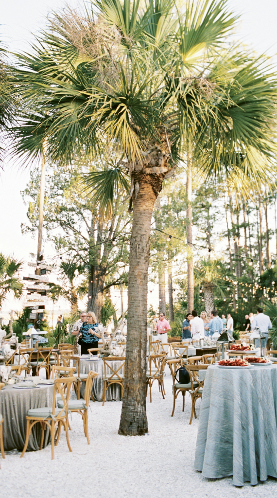 "Café lights, to-the-ground linens, and cushioned X-back chairs elevated the rustic setting. ""Mixing big city touches with South Carolina's natural charm"" was the aim of Michelle, who lives in Chicago."