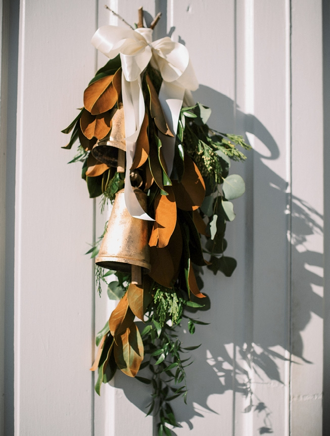 Magnolia and eucalyptus leaves tied with a simple bell adorned the church in the Old Village.
