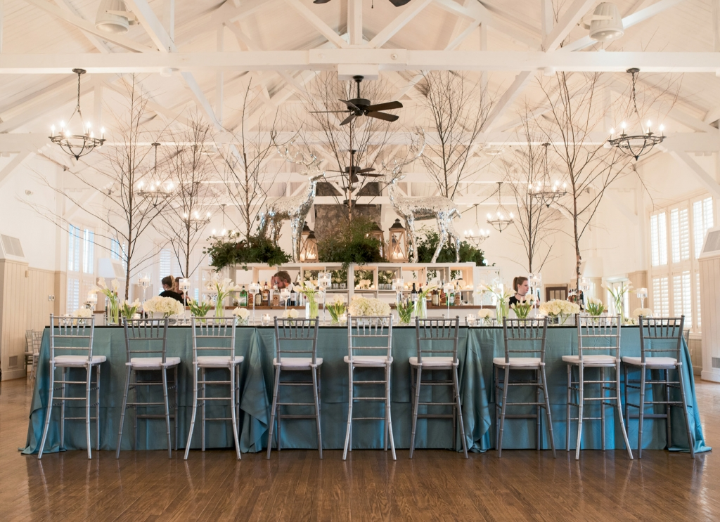 The club's main hall housed the dance floor, plus a swanky bar that kept the libations coming. Look closely for a fun detail—the chairs alternate from smoky gray to icy silver, yet another way to make an expanse more cozy.