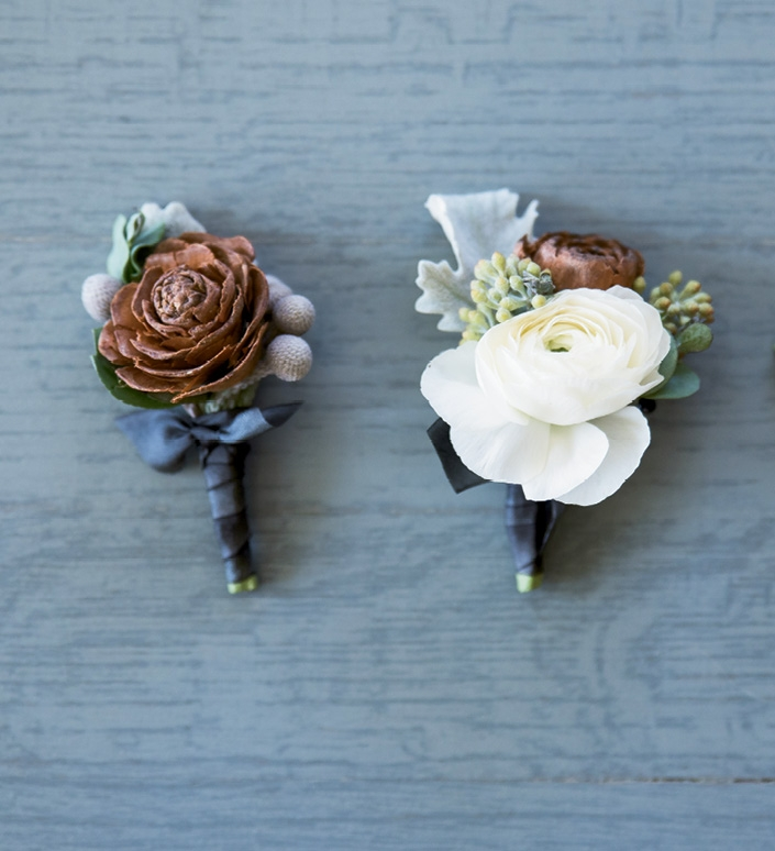 Pinecones offered an earthy twist to otherwise winter-white boutonnieres and bouquets.