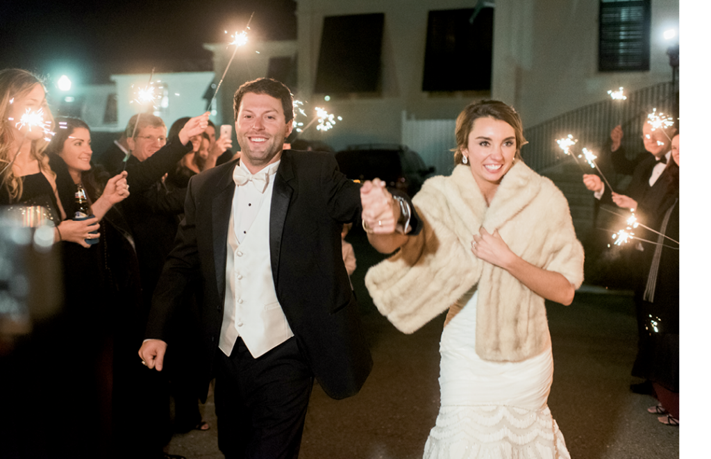 The couple left amid sparklers and were whisked off in a vintage car from Lowcountry Valet.