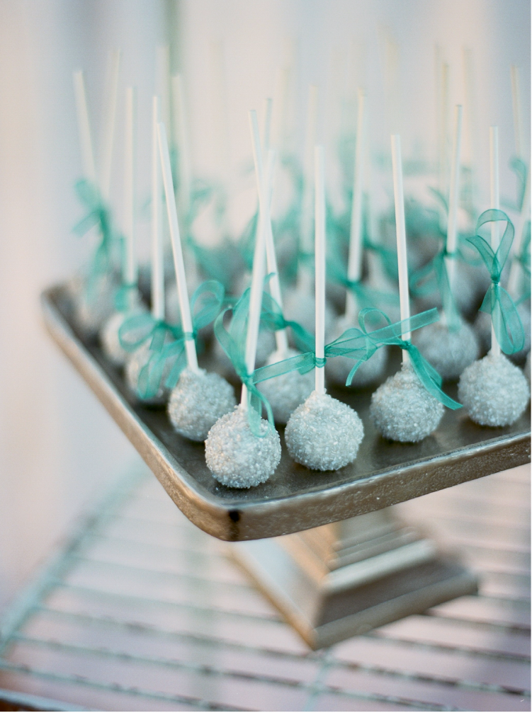 Cake pops dusted in ice blue sugar crystals were part of a dessert spread that included a towering traditional wedding cake.