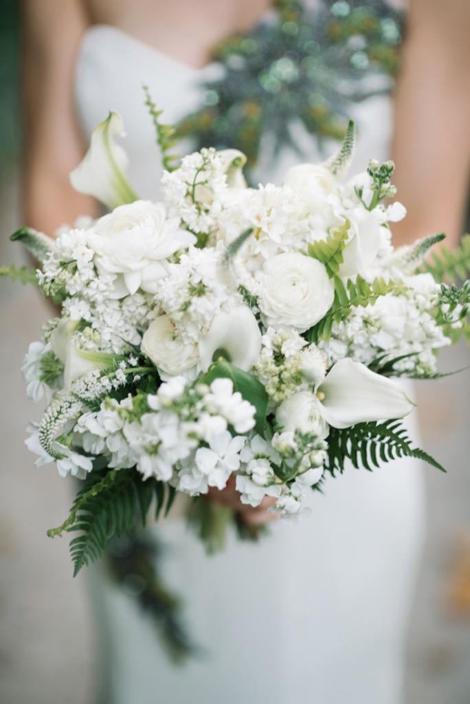 Photograph by Sean Money + Elizabeth Fay. Bouquet by Tiger Lily Weddings. Bride's attire by Luly Yang.