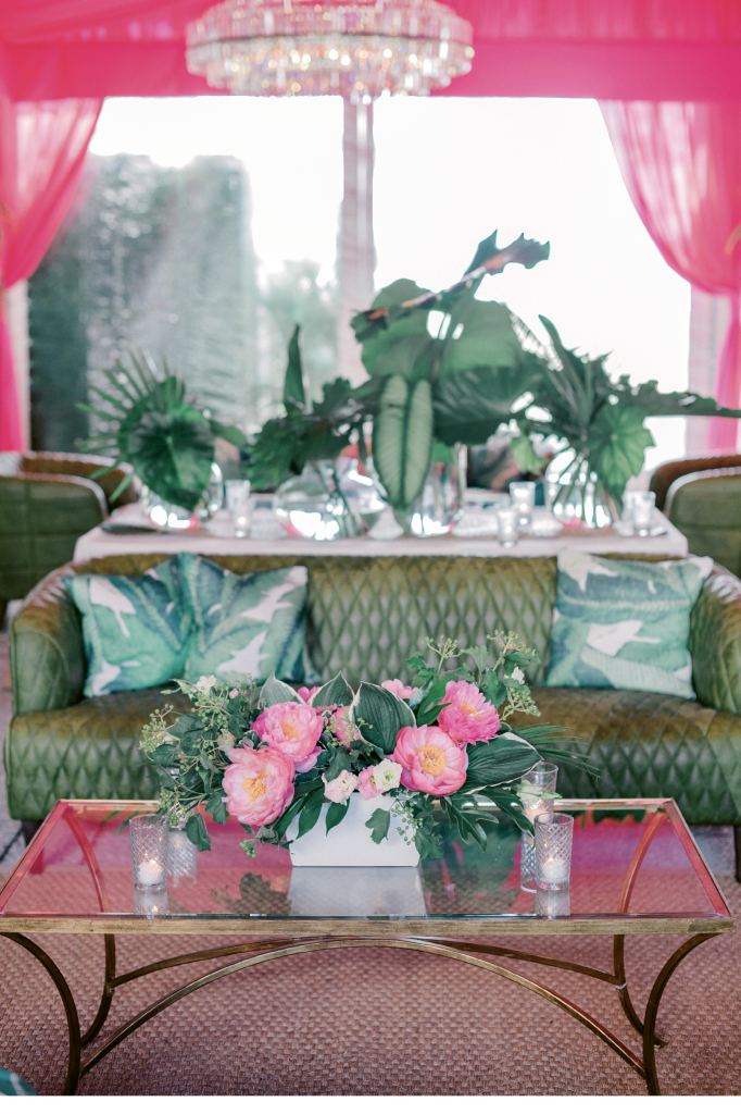 "Filling the tent with lounge appointments—leather sofas, crystal chandeliers, gauzy drapery—in vivid hues was a lively departure from the site's usual ""blush and bashful"" trappings, said planner Mary Martha."