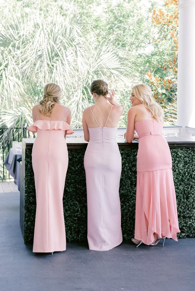 Bridesmaids acted as greeters for the guests and sat in the front row, while Taylor's sister walked the aisle and stood with her during the ceremony. While the bridal party wore pastel gowns, the maid of honor wore a palm-print frock.