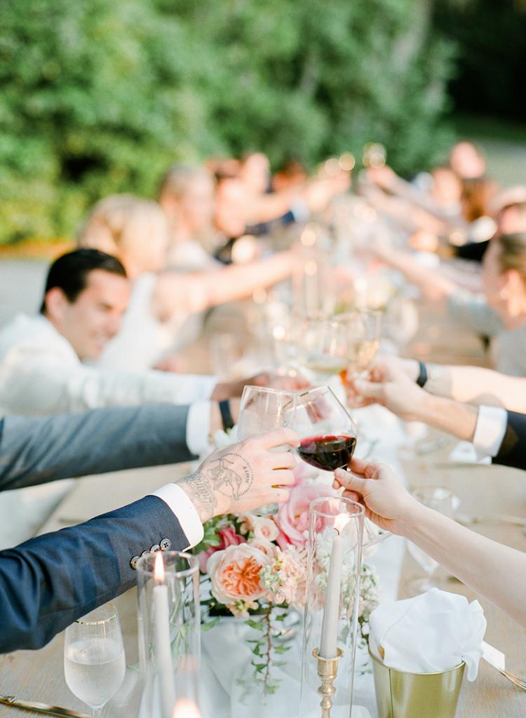Toast to that! The couple's smaller guest list allowed everyone to revel in head table pampering, from fine wine to upholstered dining chairs for all.