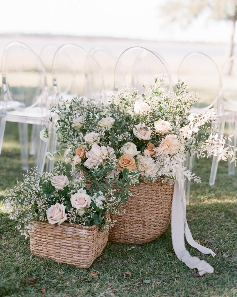 Place baskets overflowing with blooms to mark the entrance of the ceremony aisle instead of traditional markers that flank the walkway.